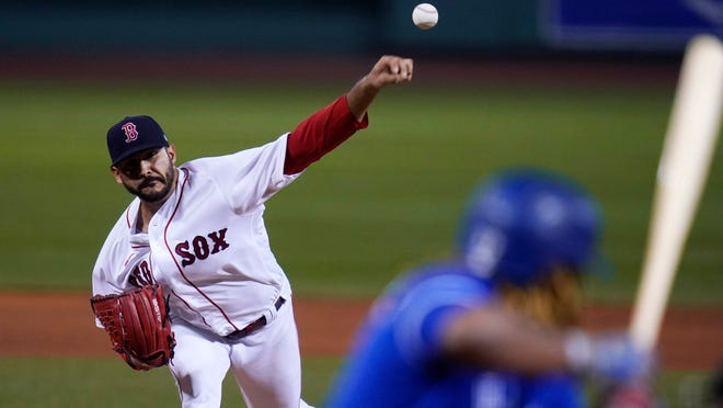 Boston Red Sox starting pitcher Martin Perez delivers during the first inning of the team's baseball game against the Toronto Blue Jays, Thursday Sept. 3, 2020, in Boston.