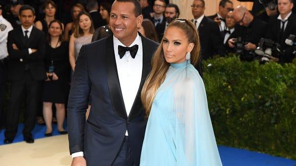 Jennifer Lopez and Alex Rodriguez attend the Costume