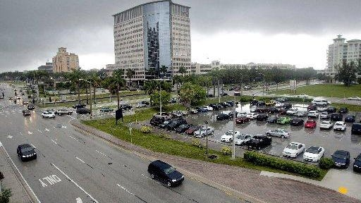 West Palm Beach's tent site, the 2.4-acre spot of land where Okeechobee Boulevard meets South Dixie Highway at the gateway to downtown, will see a 24-floor office tower under a deal approved Monday, April 20, 2020.