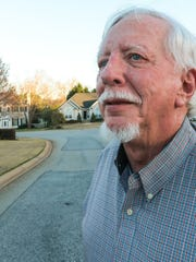 Wayne Selman of Anderson, standing on a patched up section of Laurens Court, said he would rather pay an annual fee per car than added tax at the pump to get money for road repairs in the county.