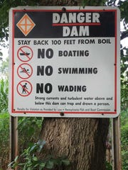 A sign warns of a dam on the Conewago Creek in York County.