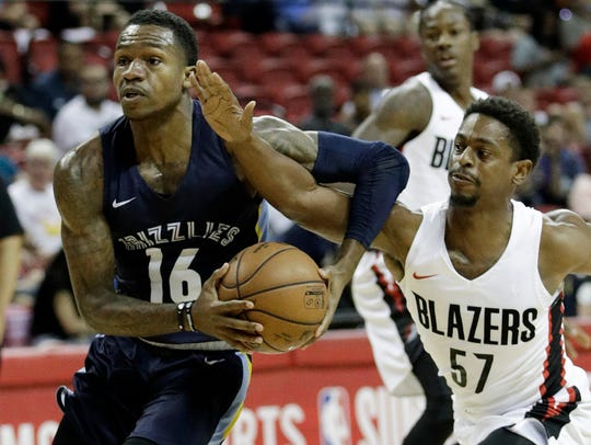 The Grizzlies' Brandon Goodwin, left, drives around the Trail Blazers' Casper Ware Jr. during a Summer League game July 16.