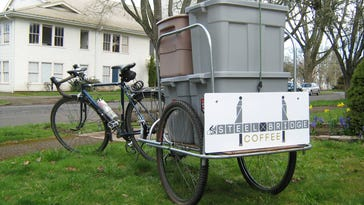 Joseph Penner built a special bicycle trailer to take his goods to Salem Saturday market.