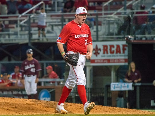 UL's Hogan Harris roars with excitement after a successful strikeout as the Ragin' Cajuns take on the Little Rock Trojans at M.L. Tigue Moore Field on Saturday April 21, 2018.