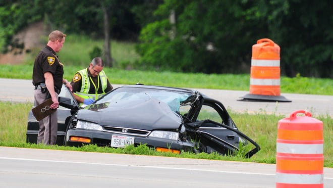 Authorities investigate at the scene of a fatal crash on Wis. 29 in Howard on July 11.
