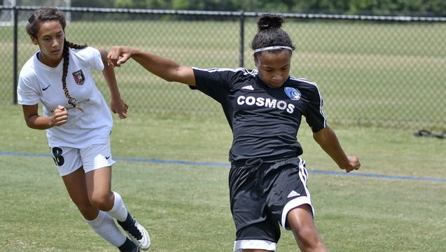 Kelbie Washington of the SLSC Cosmos Blue takes a shot during her team's 1-0 win over Lonestars 02 Red in the US Youth Soccer Region III Championships at the MeSA Complex in Greer Monday. Washington scored the goal in her team's quarterfinal victory.