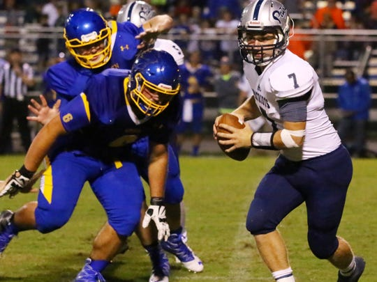 Powdersville's Emery Williams (7) scrambles out of the pocket against Wren in the second quarter of their game at Wren High School Friday night, September 2, 2016.