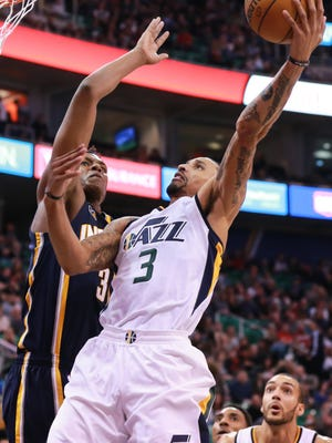 Utah Jazz guard George Hill (3) tries to shoot the ball over Indiana Pacers center Myles Turner (33) during the fourth quarter at Vivint Smart Home Arena. Utah won 109-100.