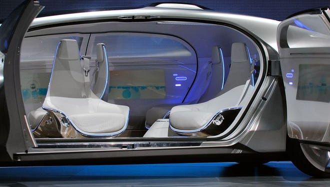 The interior of the Mercedes-Benz F015 autonomous driving automobile. The four electrically powered rotating lounge chairs swing outward by 30 degrees when the doors are opened.