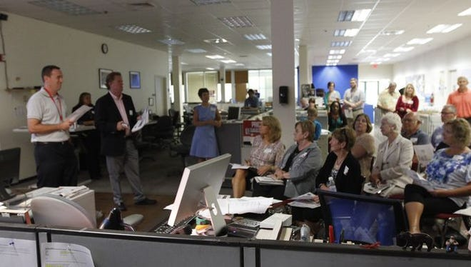 News-Press subscribers meet inside The News-Press newsroom for the morning news meeting on June 3, 2015.