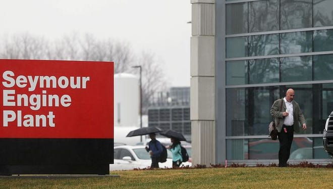 Employees and others who were inside the Cummins Engine Plant exit the building after two employees died in an apparent murder-suicide Thursday morning, March 10, 2016, in Seymour, Ind..