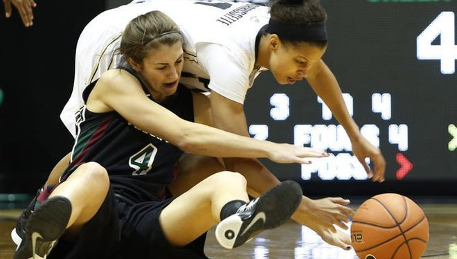 Ashley Morrissette tries to wrestle the ball away from UW-Green Bay's Kaili Lukan Wednesday, November 19, 2014, at Mackey Arena on the campus of Purdue University.