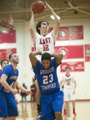 Cherry Hill East senior forward Colin O'Donnell shoots over Washington Township's Na'Quan McPherson during the third quarter of Monday's South Jersey Group 4 playoff game.