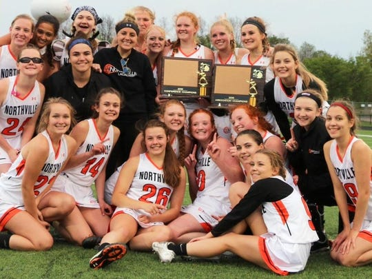 The Northville girls lacrosse team celebrates after winning the KLAA Association title with a 9-8 win over Brighton.