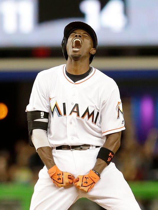 Miami Marlins' Dee Gordon celebrates after hitting a double against the Detroit Tigers in the ninth inning of a baseball game Tuesday, April 5, 2016, in Miami. Derek Dietrich scored on the double. The Tigers won 8-7. (AP Photo/Alan Diaz)
