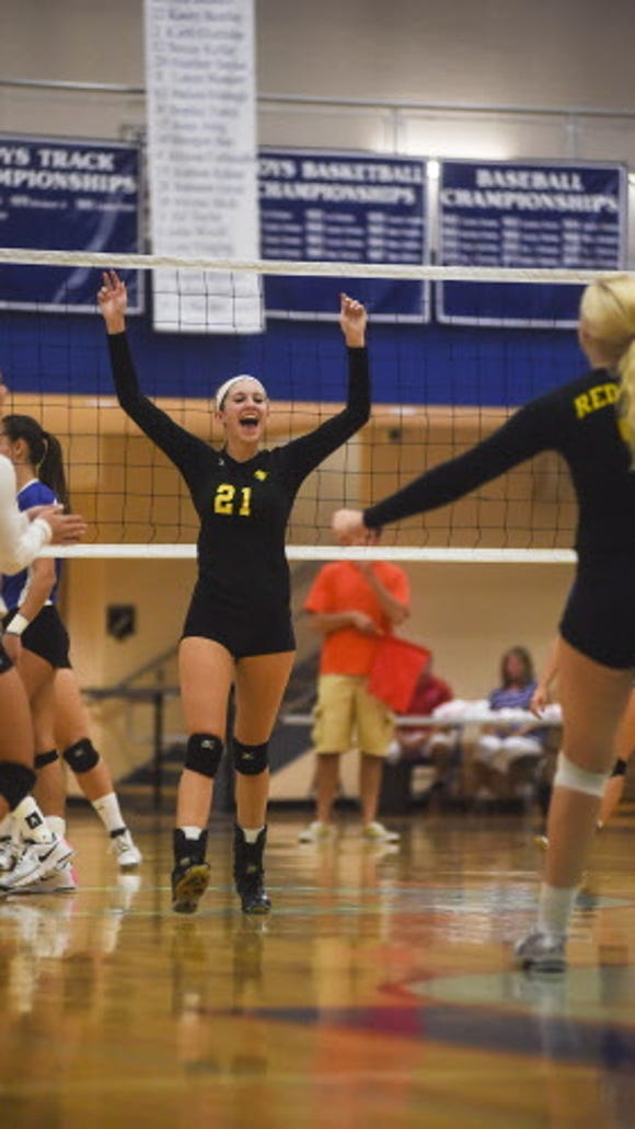 Red Lion celebrates a score against Spring Grove during Thursday's girls' volleyball game.