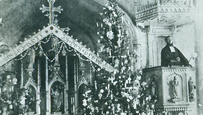 This pre-1880 image, taken a decade prior to today's story, is of the Very Reverend Henry Wickemeyer giving his Christmas sermon at the old St. John Lutheran Church on South Fourth Street. Note the holiday accoutrements beside the pulpit.