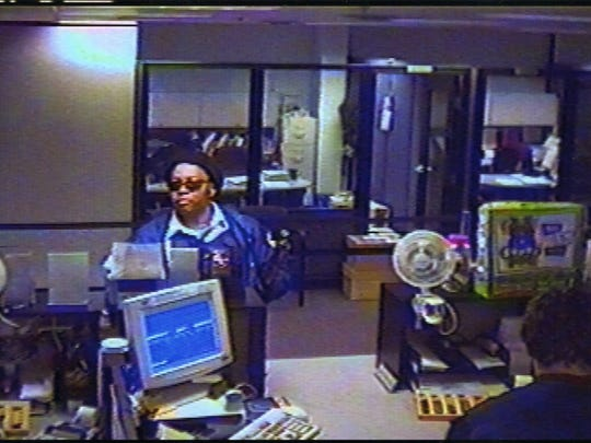 A security camera photo of the perpetrator during the 2003 robbery at the Xerox credit union in Webster.