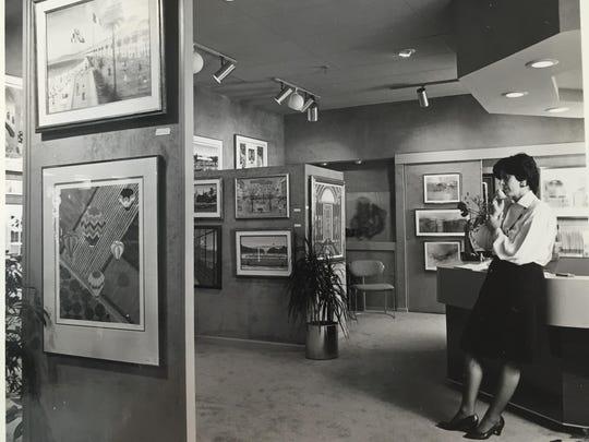 Nan Miller shown at work in the art gallery (circa