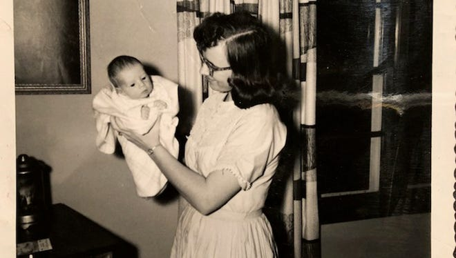 Carol Morris holds her infant son Brad not long after his adoption.
