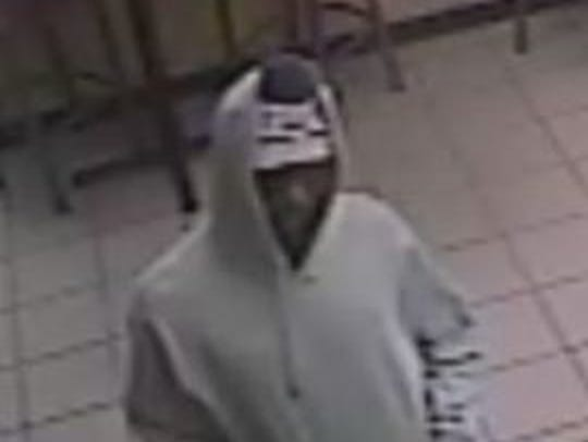 Surveillance photo of suspect in the armed robbery