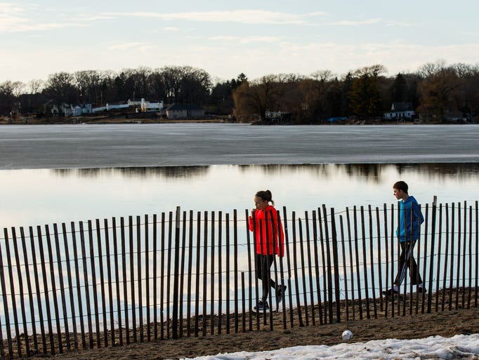Youngsters explore the lakefront at Pewaukee Beach