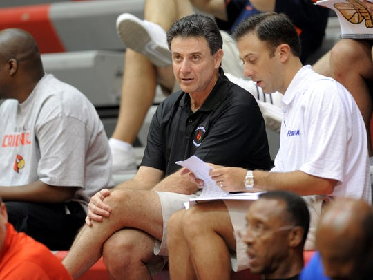 Rick Pitino talks with his son Richard Pitino at a summer-league tournament in 2010.