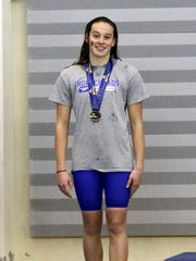 Maddy Rogan of Horseheads with her medal for her sixth-place