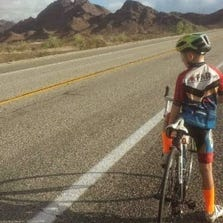 CJ Burford, 9, is on a cross-country bike ride to raise money for families of children with cancer.