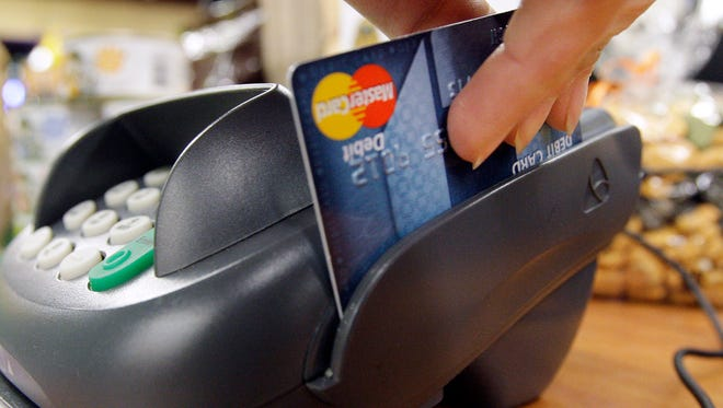 An appeals court rejected a class action settlement Visa and MasterCard had reached with retailers over swipe fees, calling it unfair.