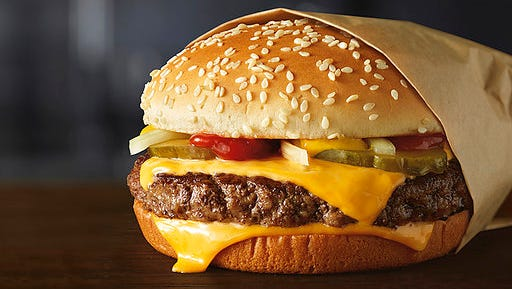 This image provided by McDonald's Corporation shows a Quarter Pounder burger. McDonald's says it will swap frozen beef patties for fresh ones in its Quarter Pounder burgers by sometime in 2018 at most of its U.S. locations. Employees will cook up the never-frozen beef on a grill when ordered.