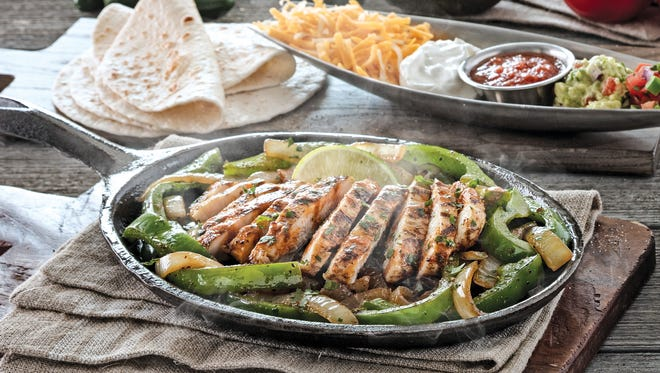 Participating Chili's restaurants have a deal on chicken fajitas for National Fajita Day.
