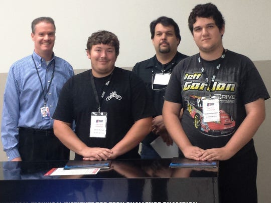 From left: UTI-Orlando President Steve McElfresh, Eau Gallie High student Chris Andros, instructor Philip Younger, and student Matthew Montalvo.