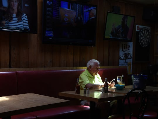 John Pislor, of Glen Rock, waits for friends at a table at Shortway's Barn on May 15.