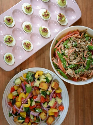 Side dishes including avocado deviled eggs, panzanella salad and soba noodle salad are great choices for a summer potluck.