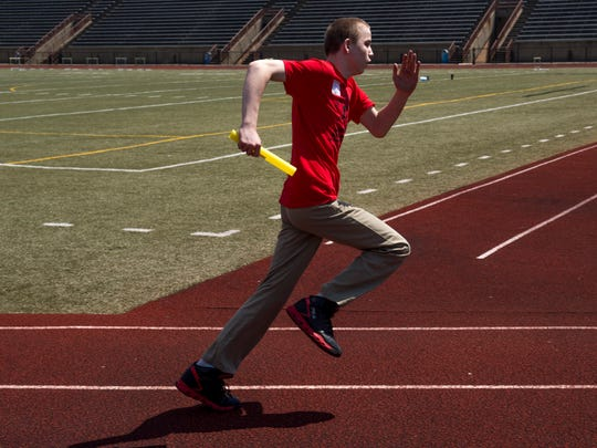 Glenwood Leadership Academy's Andrew Smith runs the first leg of the 400 meter relay at the United Champions Special Olympics meet at Central High School Tuesday morning.