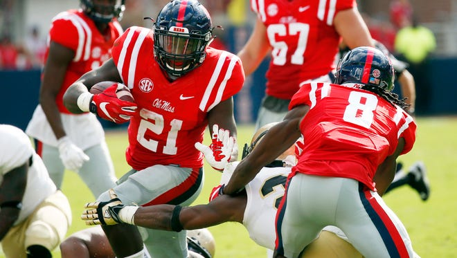 Ole Miss running back Akeem Judd runs for a first down as his teammate wide receiver Quincy Adeboyejo blocks down on a Wofford defensive player in the first half on Saturday.