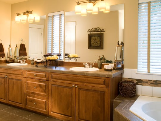 A lower-end remodel might be limited to a new countertop, a new tile surround for your tub and a fresh coat of paint. Building a new tile surround for an older bathtub is often done in bath remodels.