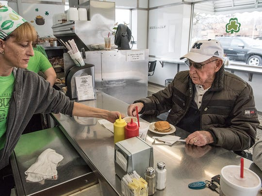 Sandi Rosa serves a cup of coffee to Harry Glasson, of Livonia. Harry has been a regular customer for 40-50 years, and remembers when Bates was open all night. He remembers dining at Bates at 3 a.m., after a New Years party.