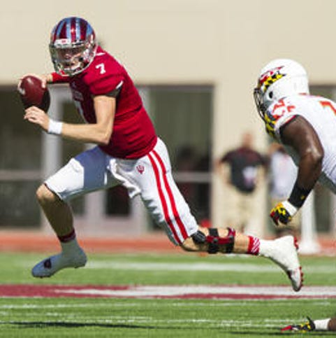Indiana University junior Nate Sudfeld (7) scrambles out of the pocket in the backfield looking for a receiver during first half action. Indiana University hosted Maryland University in Big Ten football action, Saturday, September 27, 2014.