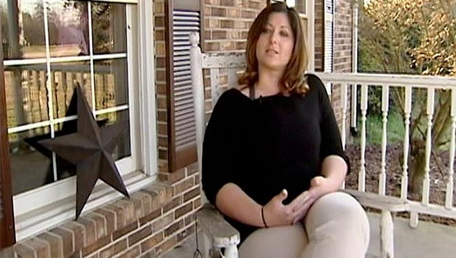In this undated image made from video and provided by WYFF News-4, Teacher Leigh Anne Arthur speaks to a reporter in Union County, S.C. Some South Carolina high school students are calling for the return of Arthur who resigned after a student spread a nude picture of her through text messages and social media. Arthur, 33, told news outlets she left her cellphone on her desk Monday as she monitored a hallway during a class change. A 16-year-old boy took her phone, and with his own phone took pictures of nude images of Arthur on her phone, she said.