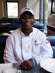 Shawn Fearon is shown in his new restaurant, Kingston
