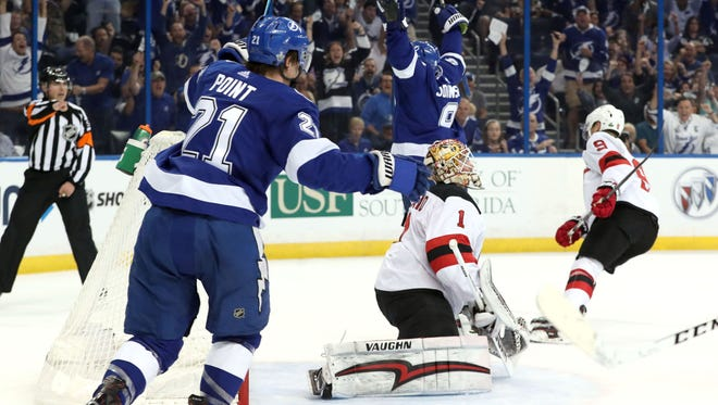 Tampa Bay Lightning center Tyler Johnson (9) celebrates as he scored a goal on New Jersey Devils goaltender Keith Kinkaid (1) during the first period of game one of the first round of the 2018 Stanley Cup Playoffs at Amalie Arena.