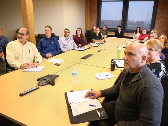 Michael Duell, architect, front right, joins with other staff in attending a webinar training session put on by LaBella University at LaBella Associates in downtown Rochester Wednesday, Nov. 16, 2016.