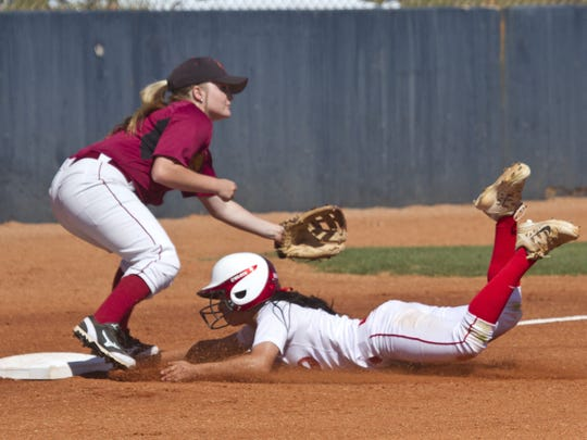 Dixie State outfielder Janessa Bassett slides into third base during against Colorado Mesa on Thursday in St. George.