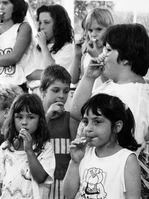 1990: Audience members participate during the finale of the All-New Kazoo Revue at Great Adventure.