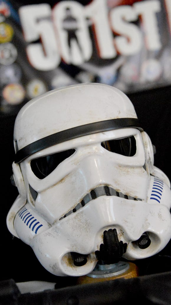 An Imperial stormtrooper helmet is among items displayed