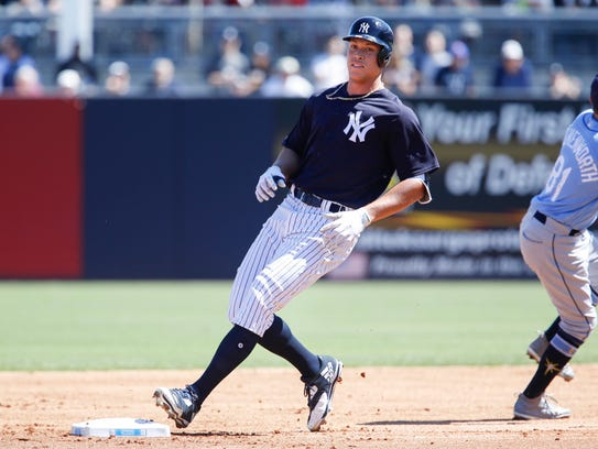 New York Yankees right fielder Aaron Judge (99) hits