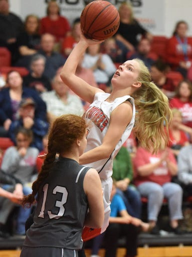 Norfork's Macy Dillard goes up for two against Izard