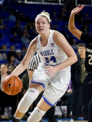 MTSU's Rebecca Reuter (24) approaches the net during the game against Southern Miss  on Saturday, Jan. 20, 2018, at MTSU.